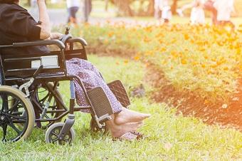 elderly person in pyjamas in their wheelchair