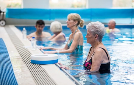Elderly patients work out in the pool
