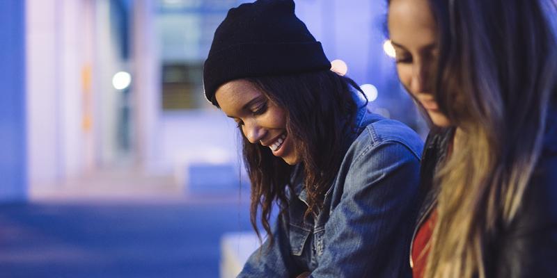 Two girls outside at night mobile slider