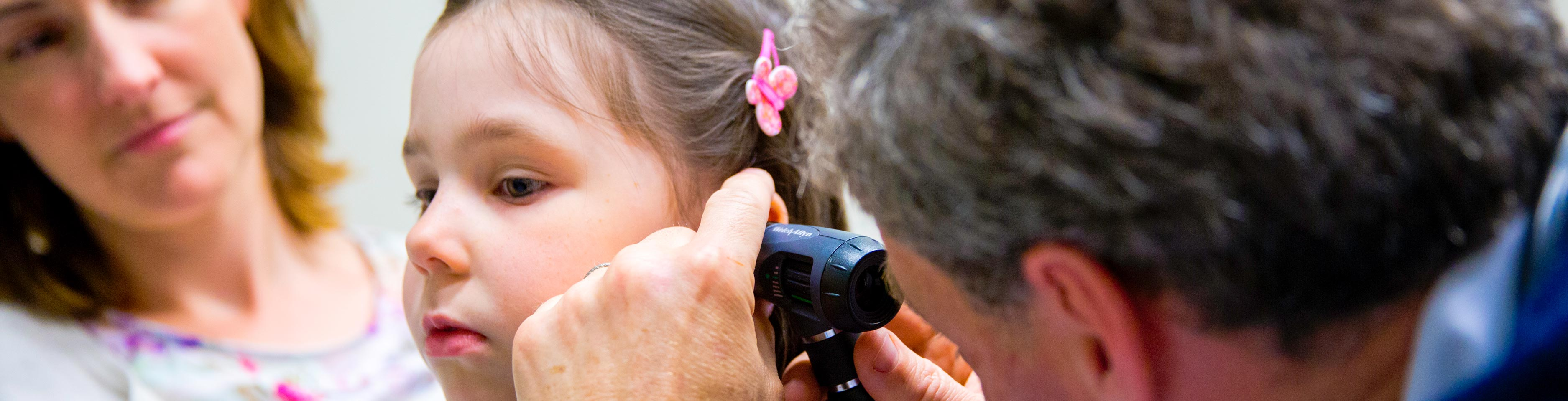 Doctor does an ear test on a young patient