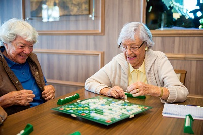 Two ladies playing Scrabble