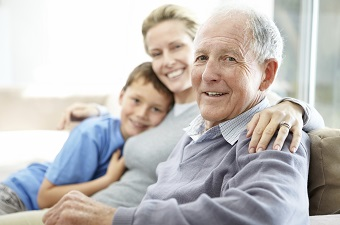 Senior man sitting with his family