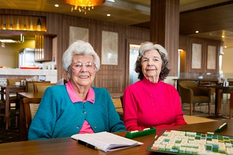 Two elderly women playing poker