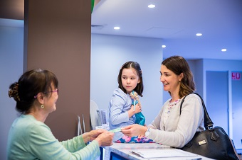 Lady and daughter at after hours clinic