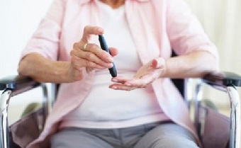 Older woman with insulin device