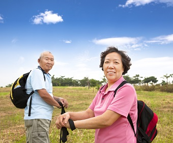 Two Chinese people walking outdoors