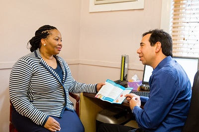 Patient visiting GP receiving brochure
