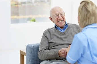Elderly man smiling in appointment