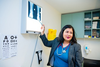 GP pointing at x ray during consult