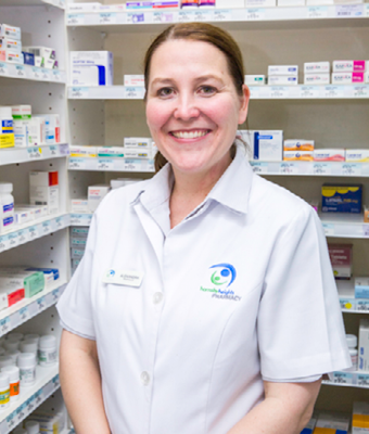 Pharmacist in chemist in front of medications