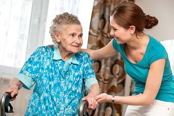 Carer helping out elderly woman in her home